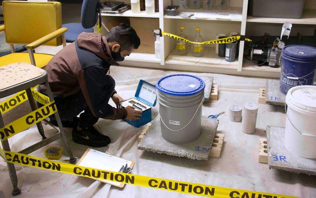 Master of engineering student Shreewan Rupakheti conducting concrete research