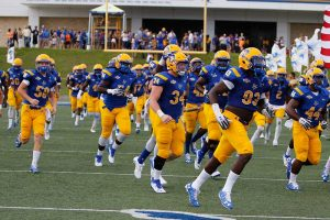The McNeese football team takes the field