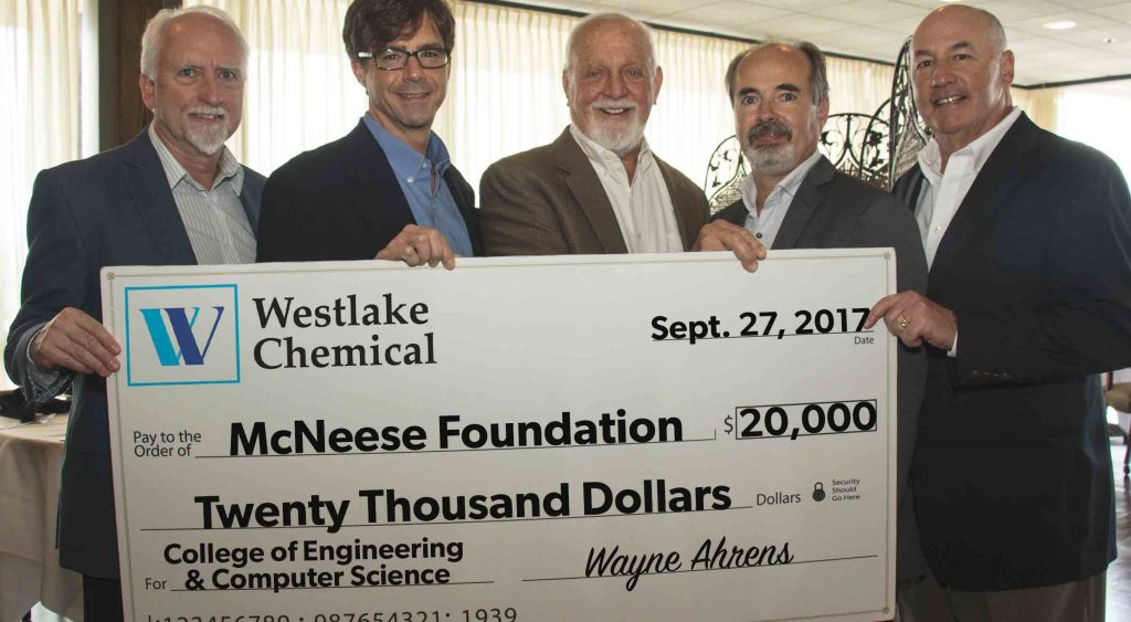 Wayne Ahrens, Curtis Brescher, and Joe Andrepont of Westlake Chemical present a check to Richard Reid and Dr. Nikos Kiritsis of McNeese.