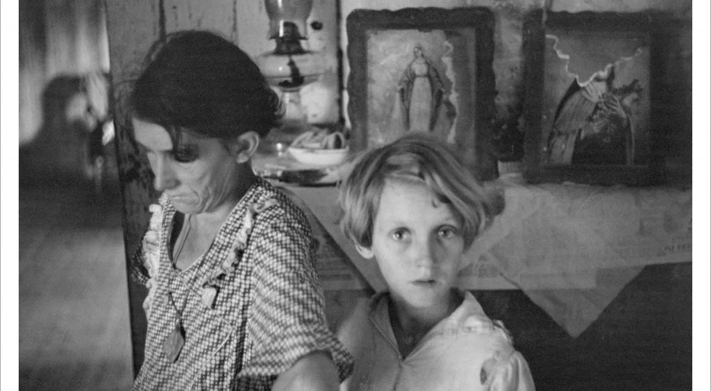 A woman and a young boy at home during the depression era.