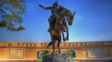 Statue of horse and rider in front of McNeese plaza.