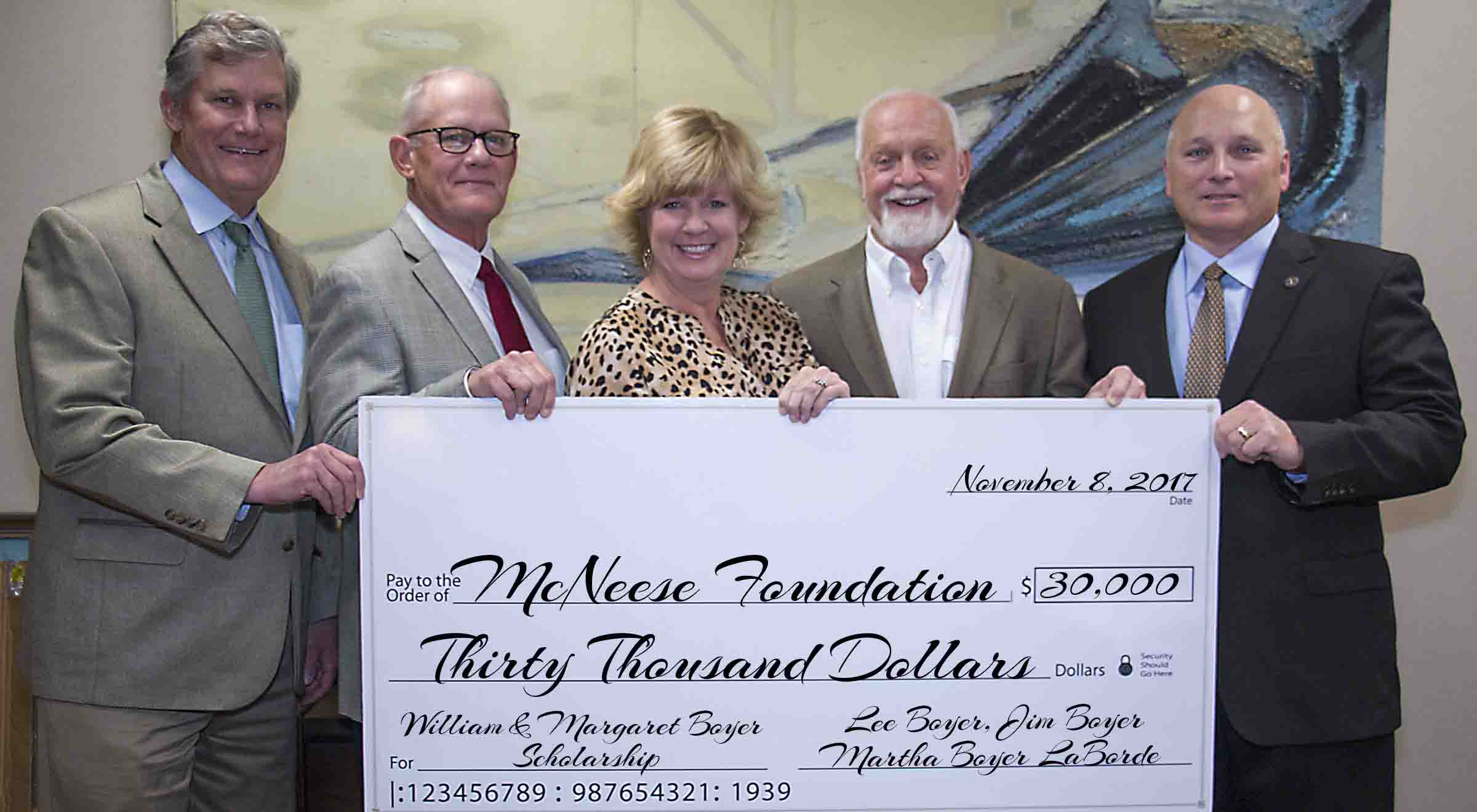 Lee and Jim Boyer with Martha Boyer LaBorde present a check to Richard Reid and Dr. Daryl Burckel of McNeese.