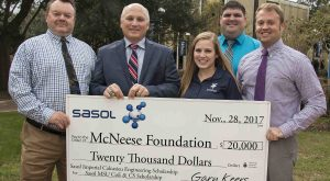 Gary Keers, Megan Landry, and Matt LeBlanc present a check to Dr. Daryl Burckel of McNeese