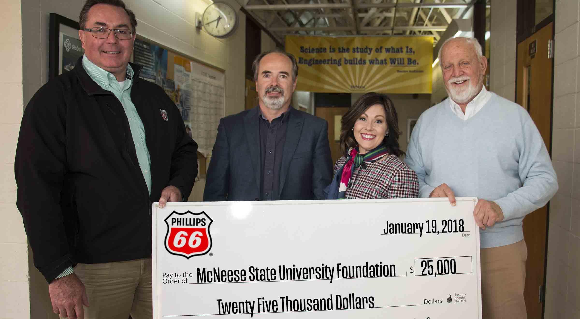 Dr. Nikos Kiritsis and Richard H. Reid of McNeese stand with Richard G Harbison and Megan Hartman of Phillips 66 for the check presentation.