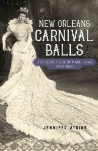 Full cover photo of Jen's book. A woman stands posing in a ball gown with a crown and scepter