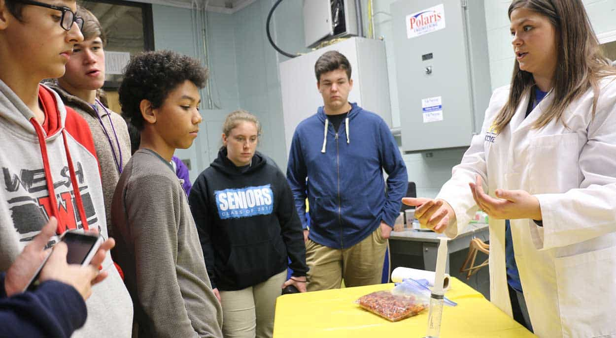 Visitors watch a demonstration by a McNeese student.