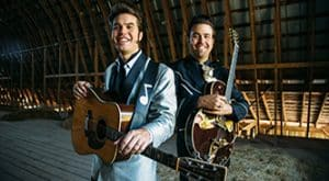 The Malpass brothers stand with their guitars