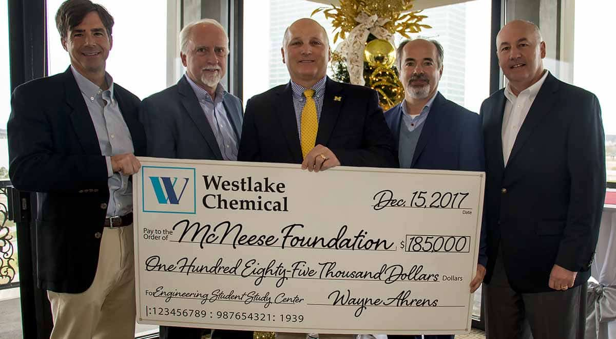 Curtis Breshcer, Wayne Ahrens, and Joe Andrepont of Westlake Chemical stand with Dr. Daryl Burckel and Dr. Nikos Kiritsis of McNeese for the check presentation.