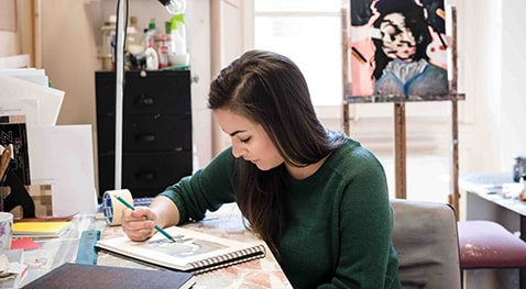 Lindsey Johnson concentrates on her drawing