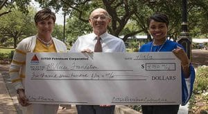 Mickey Mancuso and Petula Glaspie of Citgo present a check to Dr. Lonnie Phelps of McNeese