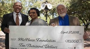 Barbara and DePorres Cormier present a check to Richard Reid of McNeese