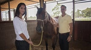 Sari Bosnyak and Dr. Edward Ferguson wit a horse