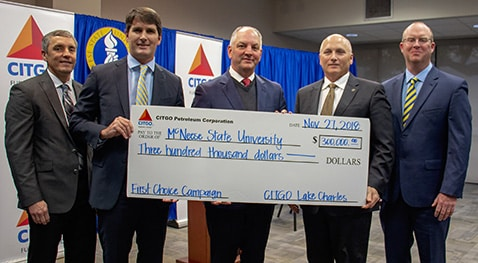 Check presentation with: Marshall Watkins, CITGO general manager operations and maintenance, Jerry Dunn, CITGO vice president and general manager, Gov. John Bel Edwards, McNeese President Dr. Daryl Burckel and Ryan Vining, CITGO general manager engineering and technical services.