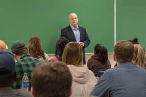 B.J. Hebert addresses the classroom full of students