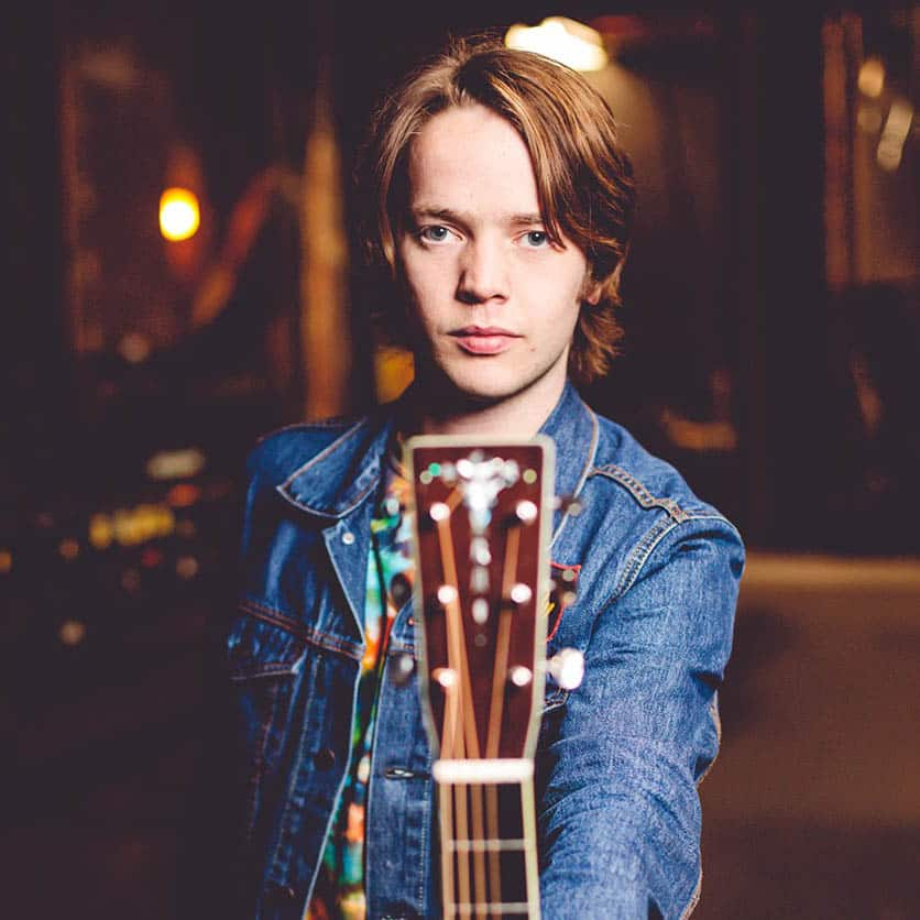 Billy Strings with his instrument