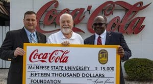 Blaine Royer, on-premise manager for Lake Charles Coca-Cola, Richard H. Reid, vice president for university advancement and executive vice president of the foundation, and Ken Francis, sales center manager for Lake Charles Coca-Cola.