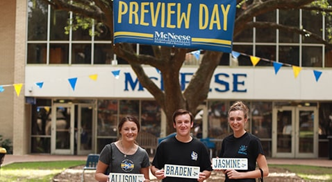 Students with Preview Day memorabilia are all smiles after a great day on campus