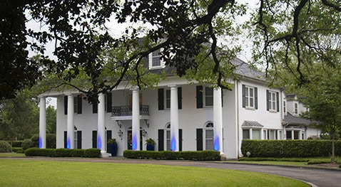 President's house lit blue for autism month.
