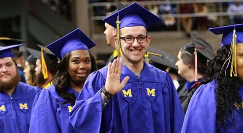 Graduates smile for the camera