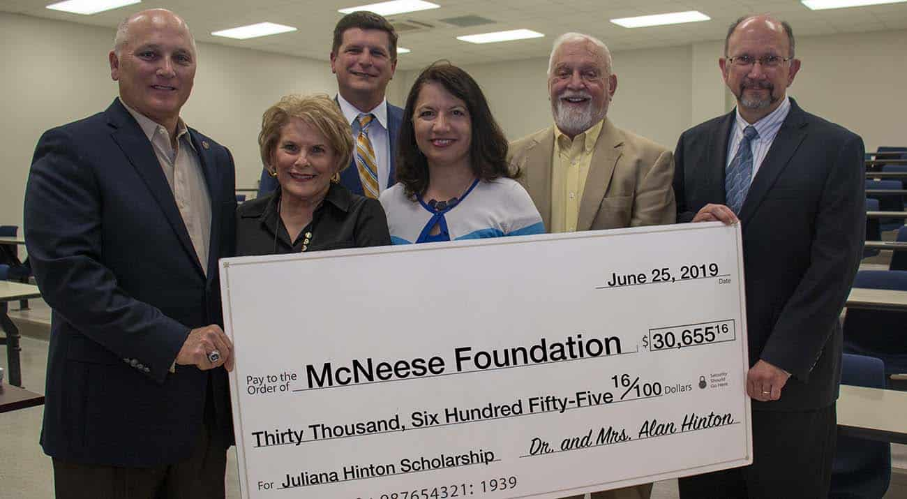 Dr. Daryl Burckel, McNeese president; Dr. Juliana Hinton, professor of biological science; Dr. M. Alan Hinton; Bridget Hinton; Richard H. Reid, vice president for university advancement and executive vice president for the McNeese Foundation; and Dr. William Dees, professor and head of the biology department at McNeese.