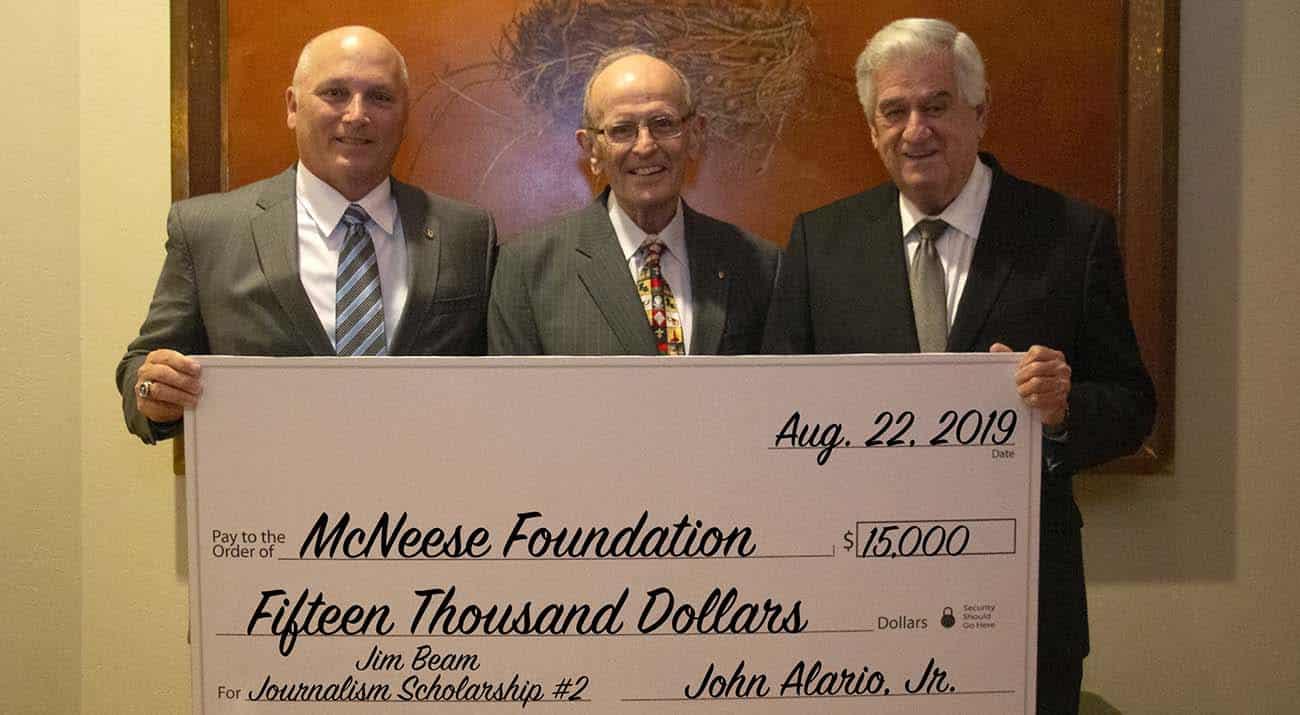 Dr. Daryl Burckel, McNeese president, Jim Beam, and John Alario Jr., Louisiana Senate president. McNeese Photo