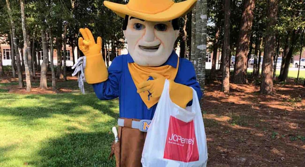 McNeese mascot Rowdy the Cowboy holds a JCPenny bag.