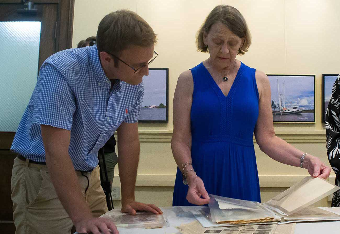 "McNeese history junior Grant Leonards reviews artifacts brought in by members of the Lake Charles community for inclusion in the 1911 Historic City Hall Arts & Cultural Center's special exhibit, ""The Pelican State Goes to War: Louisiana in World War II."""
