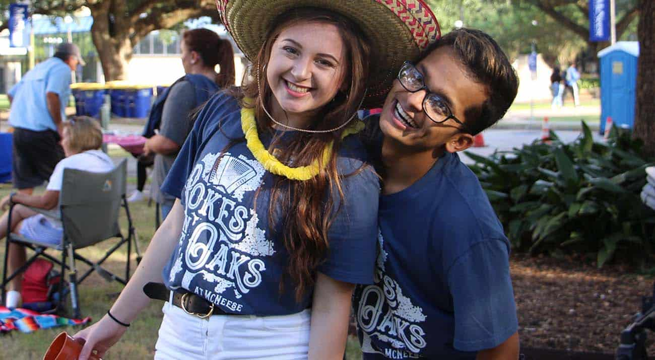 Two students smile for the camera during Pokes in the Oaks