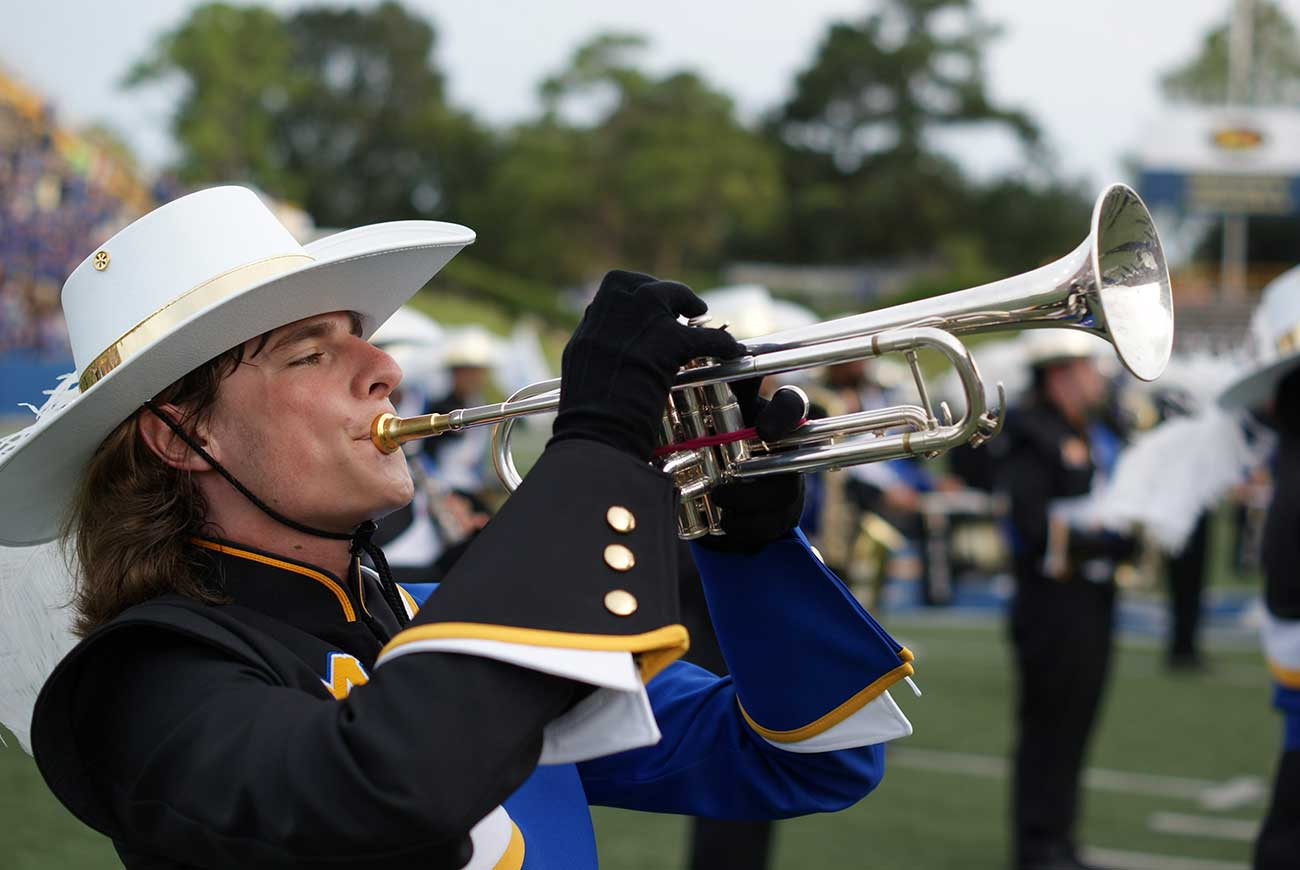 McNeese trumpter playing in the Pride of McNeese Marching Band