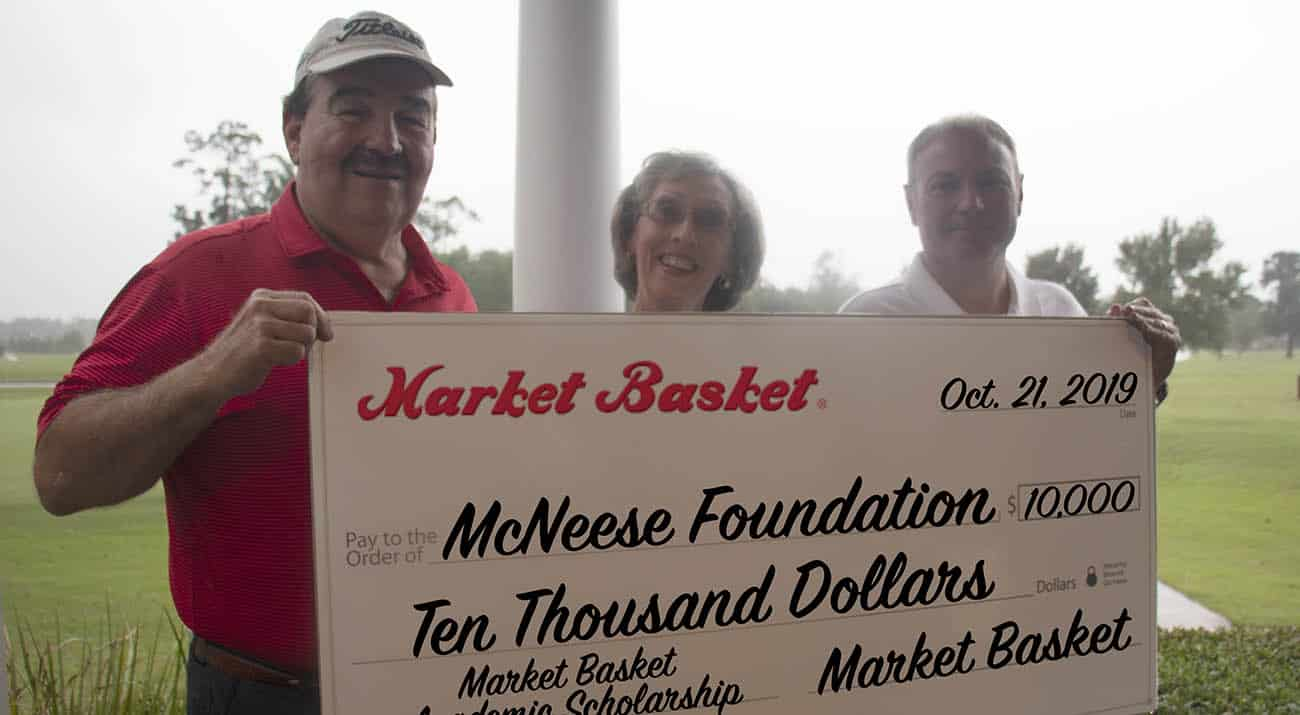 On hand for the presentation are, from left, Steve Cormier, Market Basket vice president of retail operations, Ralynn Castete, McNeese director of scholarships, and Russell Saleme, Market Basket vice president of sales and marketing.