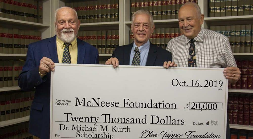 On hand for the presentation are, from left, Richard H. Reid, vice president for university advancement and executive vice president for the McNeese Foundation, Kurth and Edwin K. Hunter, Tupper Foundation trustee.