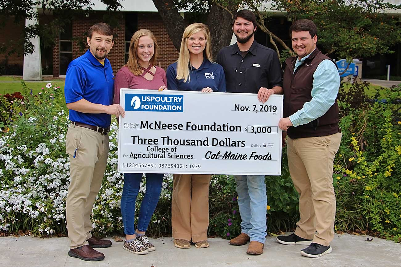 Photo of McNeese faculty and US Poultry representatives with check