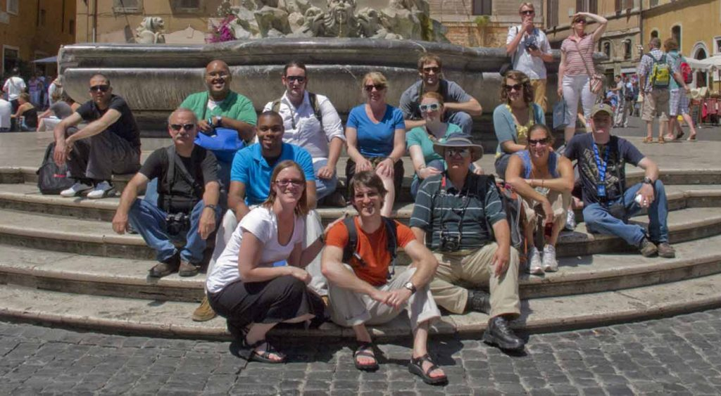 Bridget McDaniel, top row third from left, with a class in Italy.