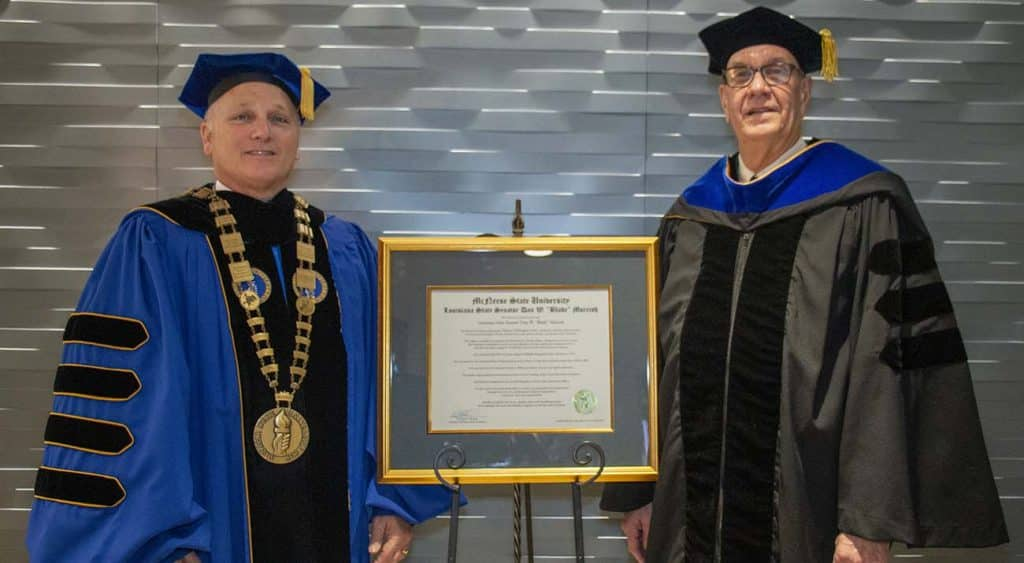 "McNeese State University President Dr. Daryl V. Burckel, left, presented Louisiana State Sen. Dan W. ""Blade"" Morrish with an honorary Doctor of Humane Letters degree during McNeese's fall commencement ceremony Saturday, Dec. 14, at the McNeese Health and Human Performance Education Complex."