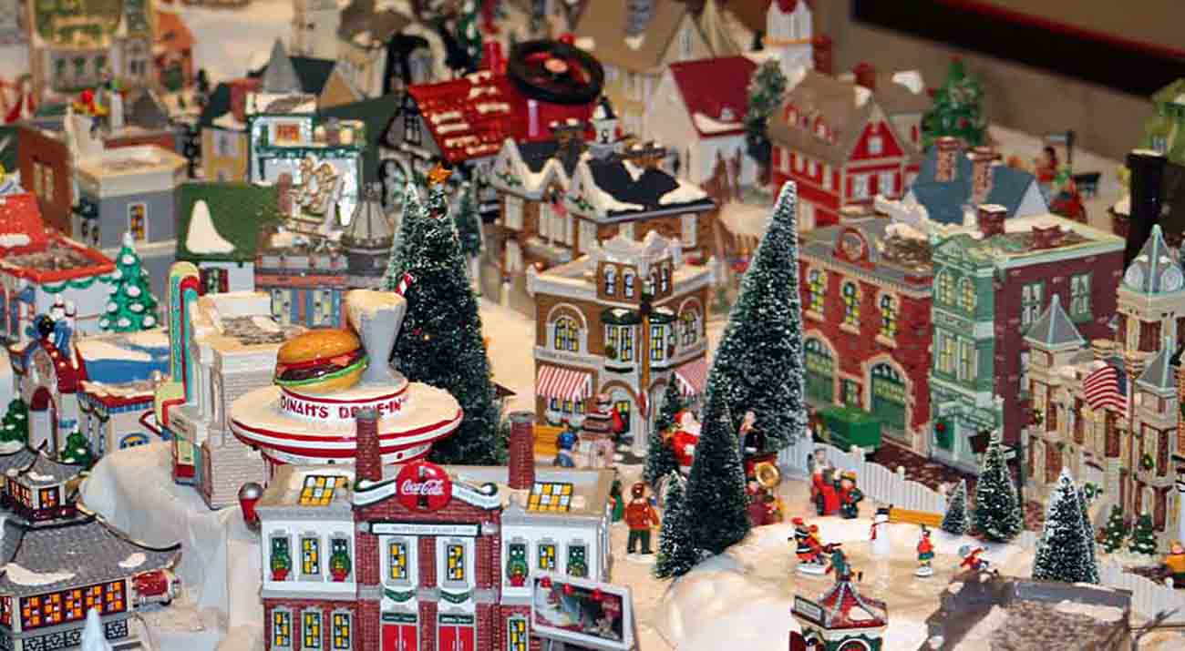A close up look at some of the buildings in the snow village.