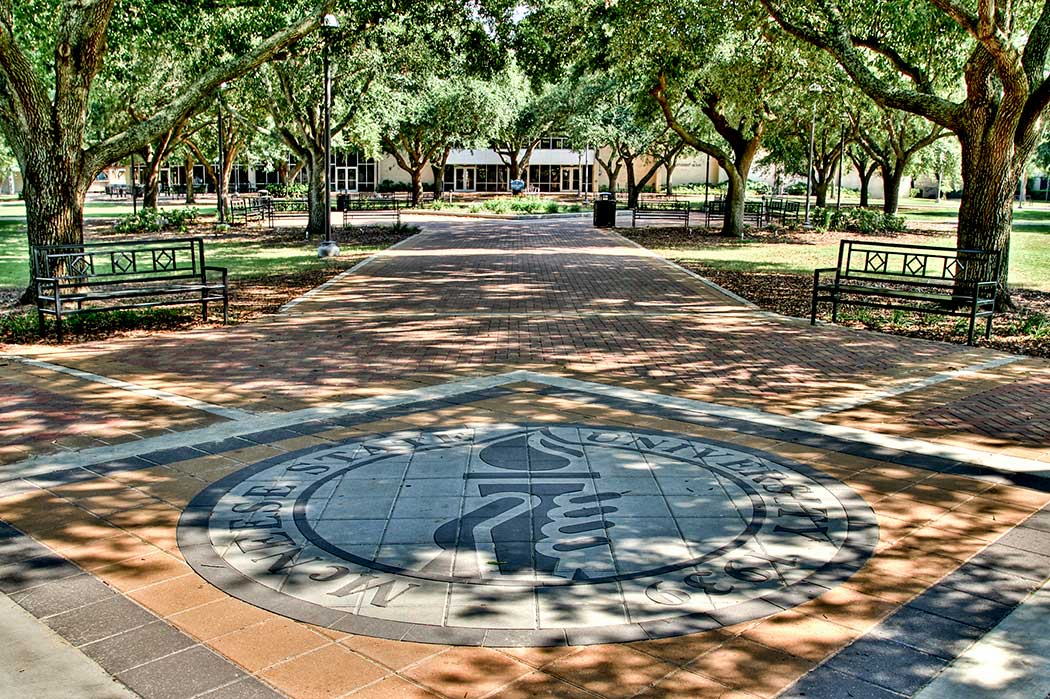 McNeese Seal under oak trees