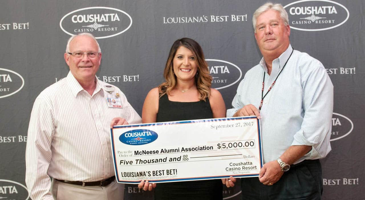 Bill Gadberry and Greg Raymor of Coushatta present a check to Stephanie Clark of McNeese Alumni.