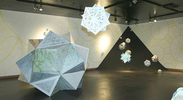 white paper sculptures similar to snowflakes by Rebecca Kreisler