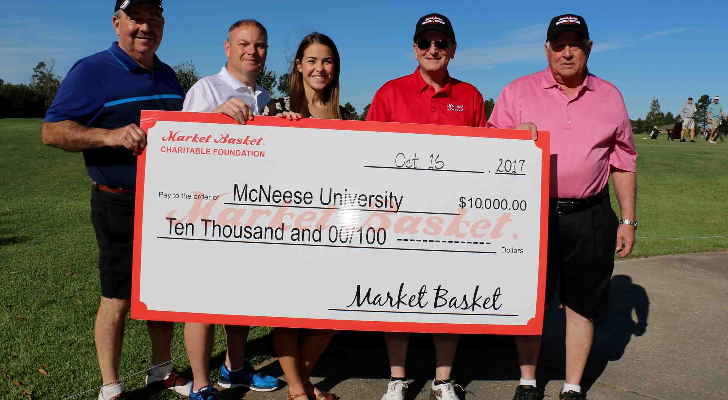 Steve Cormier, Russell Saleme, Skylar Thompson, and Keith Dauterive of Market Basket present a check to Kassidy Conrad the McNeese scholarship recipient.