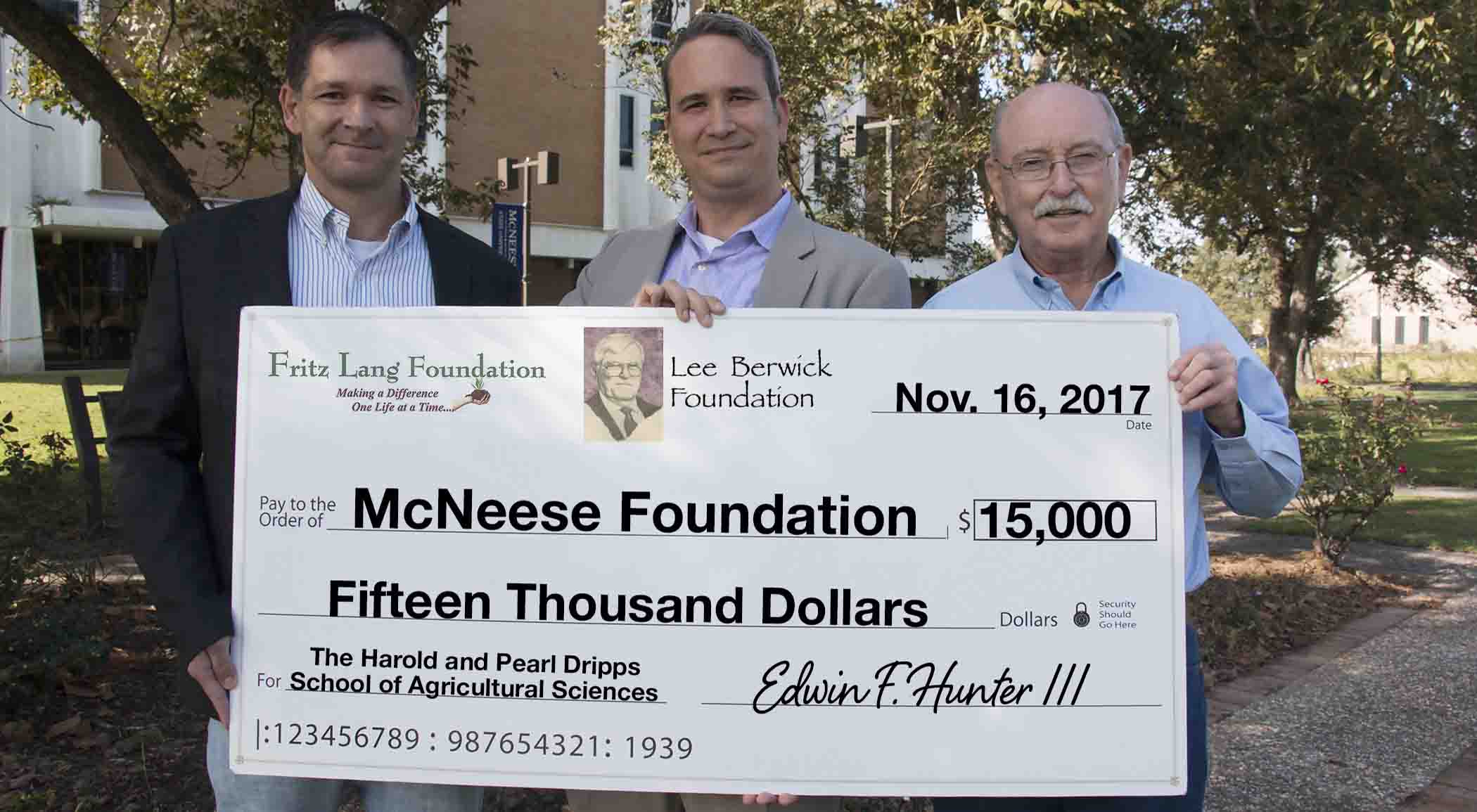 Dr. Chip LeMieux and Dwight Bertrand of McNeese accept a check from Edwin F. Hunter III of The Fritz Lang and Lee Berwick Foundations.