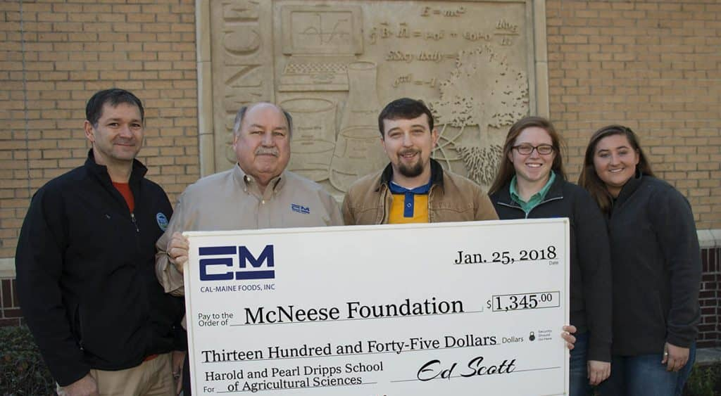 Dr. Chip LeMieux, Kealy Stelly and Shae Doucet of McNeese stand with Ed Scott of Cal-Maine Foods