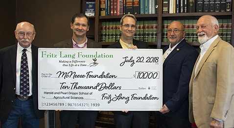 Dwight Bertrand, Dr. Chip LeMieux, Dr. Mitchell Adrian and Richard Reid of McNeese accept a check from Edwin Ford Hunter of Fritz Lang Foundation.