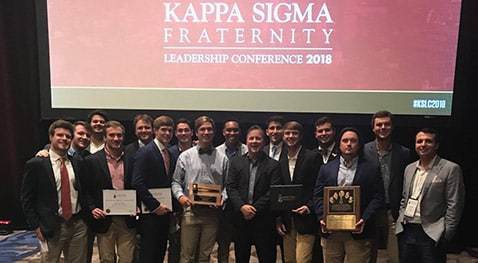 Members of the Theta Rho Kappa Sigma chapter stand with all of their awards.