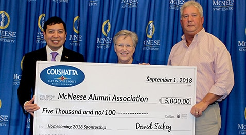 David Sickey and Greg Raynor of Coushatta present a check to Joyce Patterson of McNeese Alumni Association