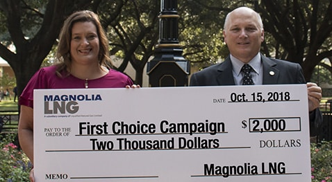 Tammy Truax of Magnolia LNG presents a check to McNeese President Dr. Daryl V. Burckel