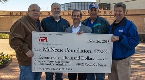 Butch Ferdinandsen, center, president-elect for the McNeese Foundation Board of Directors, accepts the donation from SWLA Chapter of API board members, from left, A.J. Vincent, James Nugent, Pat Hay and Todd Hine.