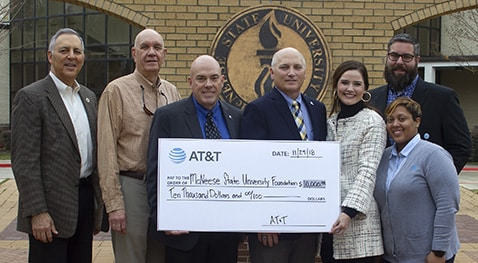 "from left, state Rep. Mark Abraham (R-District 36), Sen. Dan W. ""Blade"" Morrish (R-District 25), Blaine E. Kelly, strategic account lead, government and education solutions, AT&T Services, McNeese President Dr. Daryl Burckel, Sarah Allen, regional director, external and legislative affairs, AT&T Services, Chance Henry, AT&T retail store manager for Sulphur, and Meghan Perrodin, AT&T assistant store manager in Lake Charles."