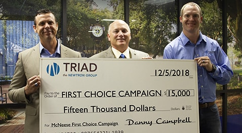 Danny Campbell, Lake Charles Triad general manager, McNeese President Dr. Daryl V. Burckel and Cody Stroud, Lake Charles Triad business development manager.