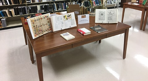 Books are on display during the rare books petting zoo