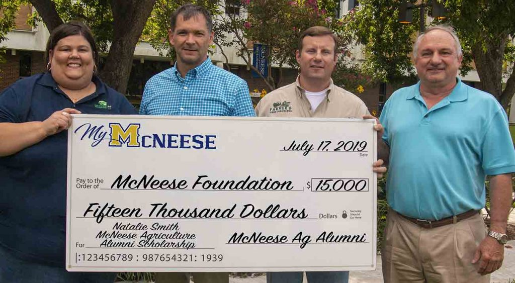 Dr. Chip LeMieux, second from left, dean of the College of Agricultural Sciences, accepts the donation from Agriculture Alumni Chapter executive officers, from left, Jennifer Compton, Jon Streete and Wayne McVicker. McNeese Photo